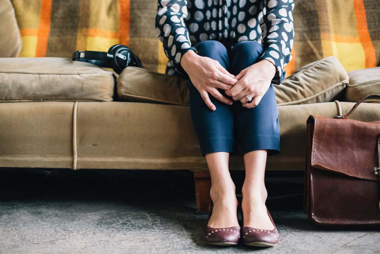 lady holding hands around knees